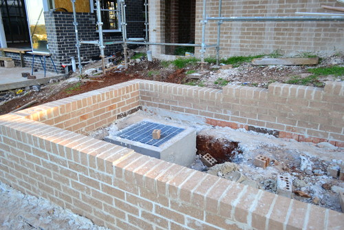 What purpose does a Stormwater retention pit serve?